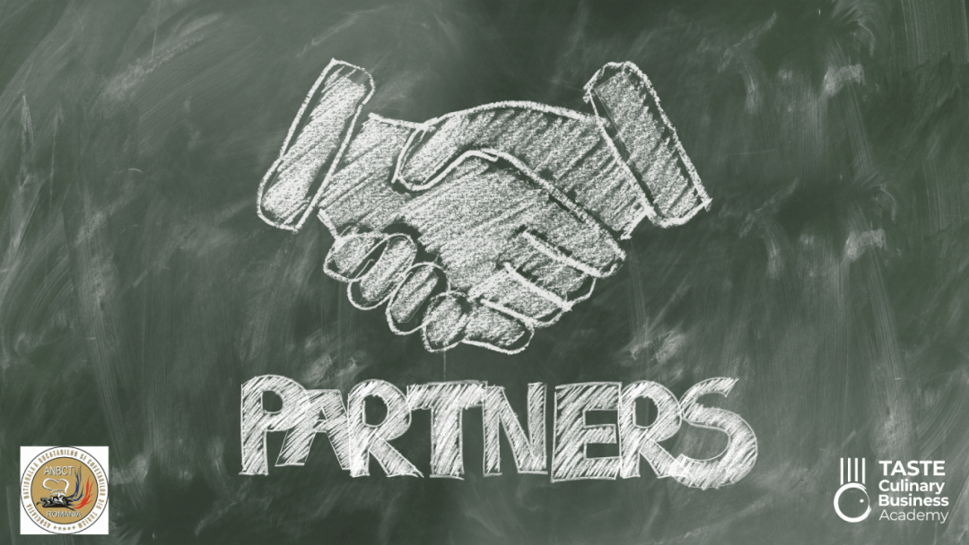 symbolic partnership handshake drawing on a blackboard between taste culinary business academy and anbct